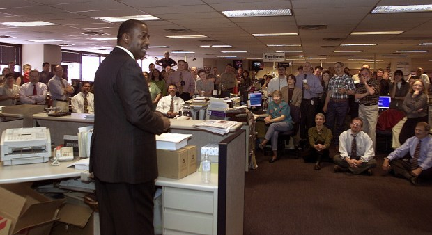 New Denver Post Editor Greg Moore talks to the news staff during a meeting in The Denver Post newsroom after he was introduced by publisher William Dean Singleton.