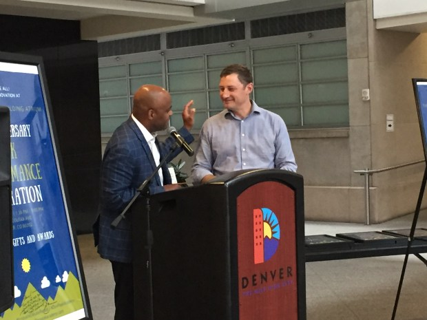 Denver Mayor Michael Hancock, left, greets Denver Peak Academy director Brian J. Elms on Aug. 17, 2017, during a fifth-anniversary event for the program in the Webb administration building's atrium.
