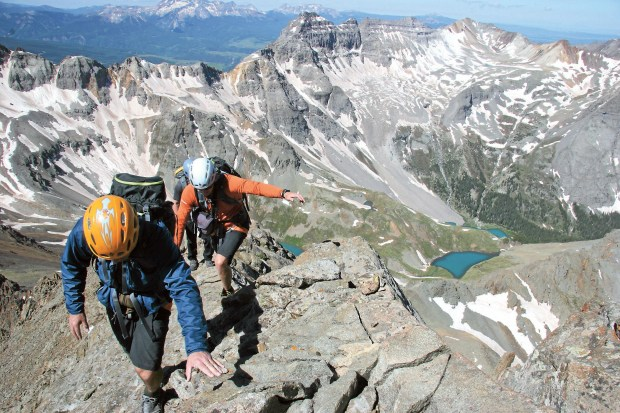 Mountain climbers make their way along the summit ridge of 14,150-foot Mount Sneffels near Ouray on July 4, 2010. At least four people have died on Colorado's fourteeners this year.