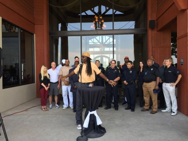 The Rev. Leon Kelly of Open Door Youth Gang Alternatives stood with supporters Wednesday to announce a successful effort to prevent gang-related homicides in an East Denver neighborhood during the summer.