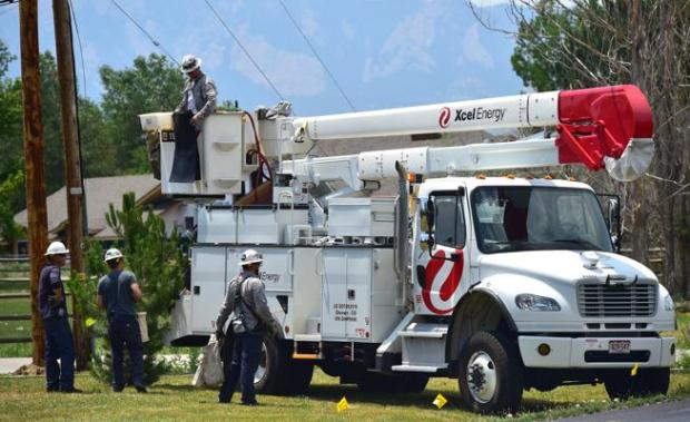 Xcel Energy crews work on replacing power poles in the 7700 block of Baseline Road on July 6.