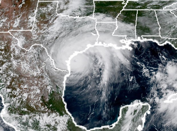 This National Oceanic and Atmospheric Administration satellite image taken on Aug. 25 shows Hurricane Harvey approaching the coast of Texas.