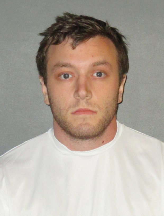 Kenneth Gleason is shown in an undated booking photo provided by the East Baton Rouge Sheriff's Office. Police believe the slayings of two black men in Baton Rouge were likely racially motivated and said Sunday, Sept. 16, 2017, that they have a person of interest — Gleason— in custody. Gleason, was being held on drug charges. Authorities do not yet have enough evidence to charge him with murder, Baton Rouge Sgt. L'Jean McKneely told The Associated Press. (East Baton Rouge Sheriff's Office via AP)