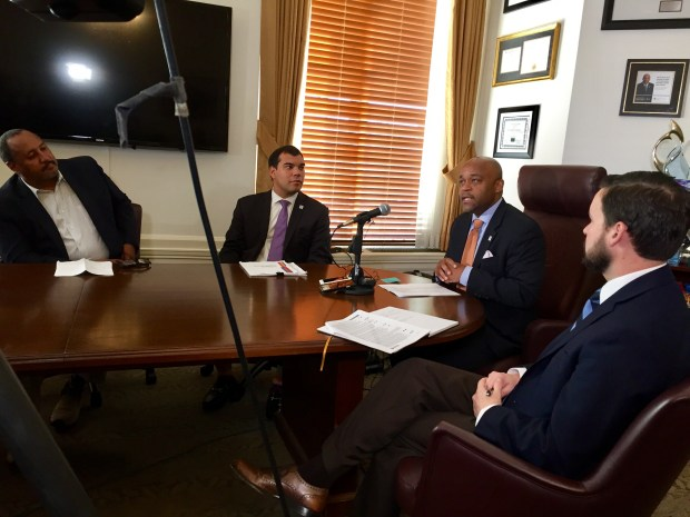 Denver Mayor Michael Hancock, second from right, discusses the release of the new Housing an Inclusive Denver affordable-housing plan on Sept. 29, 2017. With Hancock are, from left, Housing Advisory Committee chair Kevin Marchman, housing coordination director Erik Soliván and chief financial officer Brendan Hanlon.
