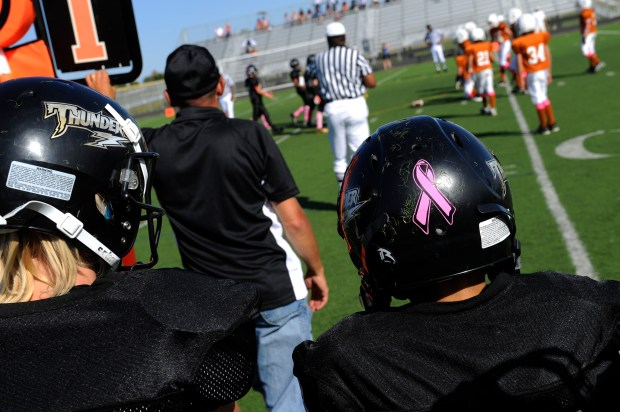 Two teams from the Rocky Mountain Pop Warner League play each other in this 2011 file photo.