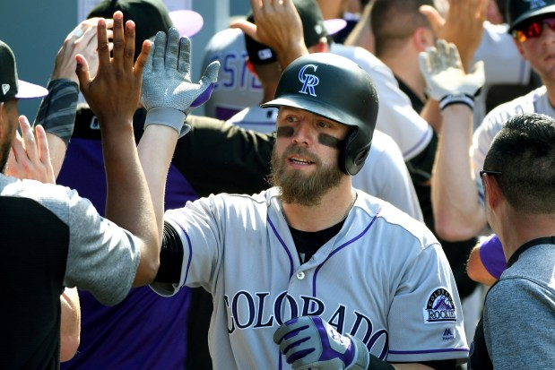 Colorado Rockies' Mark Reynolds is congratulated ...