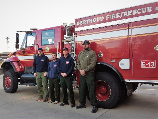 From left, Berthoud Fire Protection District firefighter Alec Huggins, firefighter Ryan Ruland, engine boss Jesse Treat, and firefighter Chris Robinson pose for a photo outside the Berthoud fire station before departing to California to assist with the massive wildland fires burning in the state.