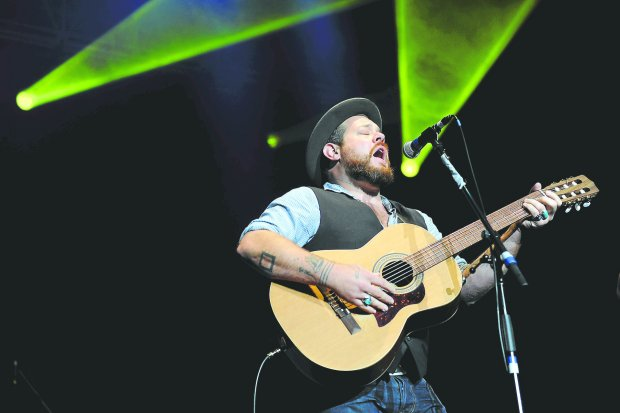 Nathaniel Rateliff performs during the Colorado Rising flood relief benefit concert at the 1st Bank Center on Oct. 27, 2013 in Broomfield. Dave Matthews and prominent members of the Colorado music scene performed to benefit flood relief in Colorado.