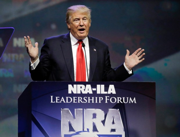 Republican presidential candidate Donald Trump speaks at the National Rifle Association convention on May 20, 2016, in Louisville, Ky. Gun sales, which skyrocketed during Barack Obama's presidency, have dropped significantly under President Trump.