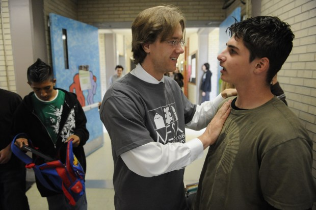 Then-Mapleton Expeditionary School of the Arts, School Director, Michael Johnston, left, talks with student, Jeremy Brittain, 17-years-old, a Junior at MESA, in the hallways of the school in May 2014. Then-candidate Barack Obama visited the school as part of his 2008 presidential campaign in Colorado.