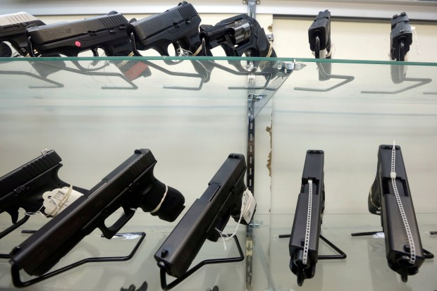 Firearms are displayed at a gun store in Miami on June 29, 2016.
