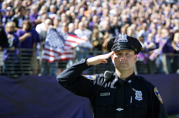 A Baltimore police officer stands during the national anthem before the Baltimore Ravens host the Pittsburgh Steelers at M&T Bank Stadium on Oct. 1.