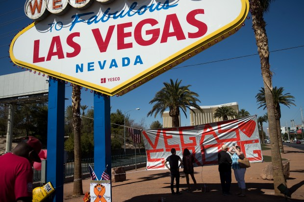 "LAS VEGAS, NV - OCTOBER 5: A ""Vegas Strong"" banner hangs near the ""Welcome to Fabulous Las Vegas"" sign at the south end of the Las Vegas Strip on Thursday."