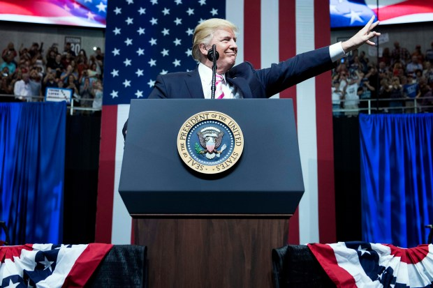 President Donald Trump waves during rally a for Alabama state Sen. Luther Strange in Huntsville, Ala., on Sept. 22.