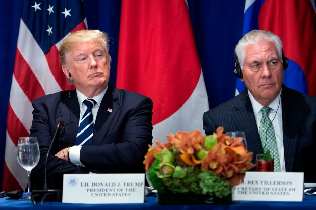 President Donald Trump and Secretary of State Rex Tillerson listen to statements before a luncheon with U.S., Korean and Japanese leaders at the Palace Hotel during the 72nd United Nations General Assembly in New York City on Sept. 21.