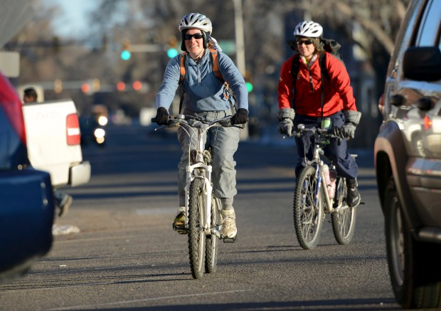 Cyclists ride to work in Longmont on Jan. 27, 2016.