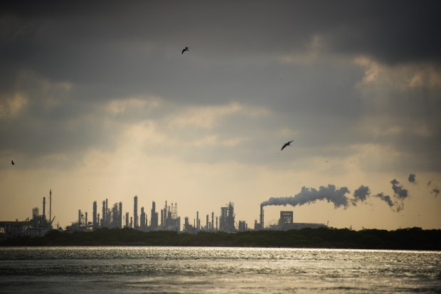 Oil refineries line the port channel, ...
