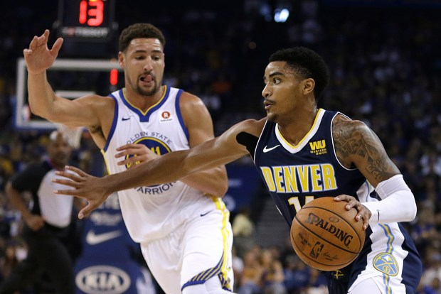 Denver Nuggets' Gary Harris, right, drives ...