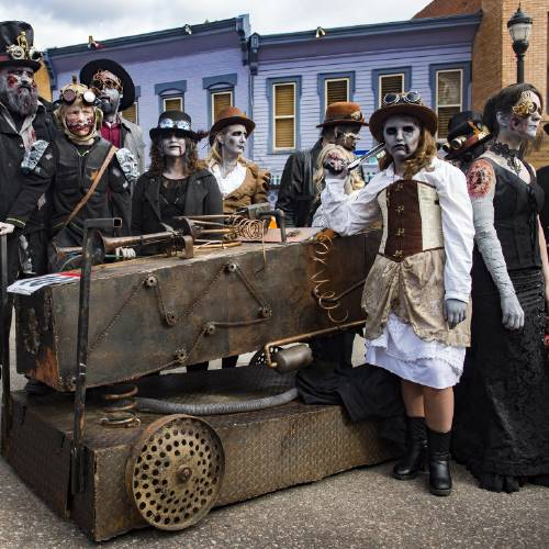 Members of the Steampunk Zombies stand next to their coffin during the 23nd annual Emma Crawford Coffin Race and Parade in Manitou Springs on Saturday October 28, 2017.