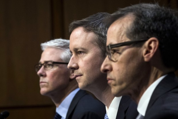 Colin Stretch (left), general counsel at Facebook, Sean Edgett (center), acting general counsel at Twitter, and Richard Salgado, director of law enforcement and information security at Google, testify during a Senate Judiciary Subcommittee on Crime and Terrorism hearing on Tuesday at the U.S. Capitol.