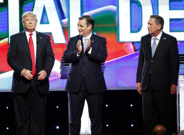 Republican presidential candidates Donald Trump, Sen. Ted Cruz and Ohio Gov. John Kasich stand on stage before the start of a March 10, 2016 presidential debate in Coral Gables, Fla.