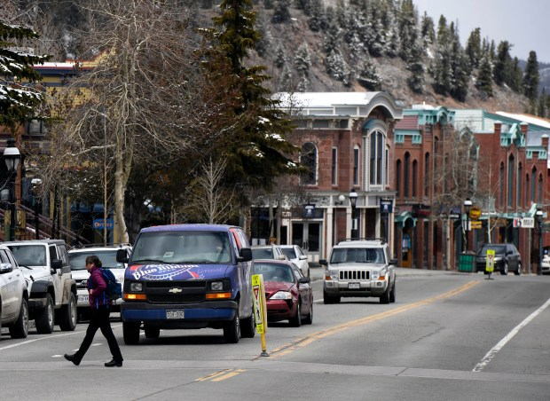 A pedestrian crosses Main Street in Breckenridge last spring. With the arrival of ski season, the annual scramble for housing in Breckenridge and other resort areas is ramping up.