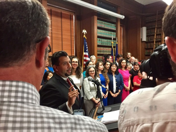 Denver City Council member Paul López speaks on Aug. 31 during an ordinance-signing ceremony for a measure that establishes a legal defense fund for immigrants, including some who are in the country illegally. This week, the City Council approved $200,000 in spending next year for the fund.