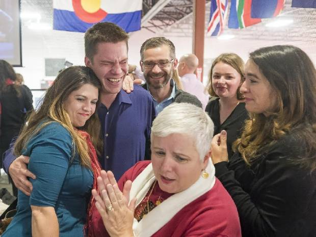 Lauren Hug, Anthony Carlson, Shawn Gullixson, Carley Cribbs and Mary Coleman, from left to right, and Teresa Null, front, celebrate the passing of 3E at SoccerHaus on Tuesday Nov. 7, 2017 in Colorado Springs.