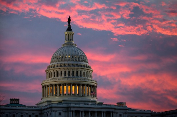 The Capitol is seen at dawn ...