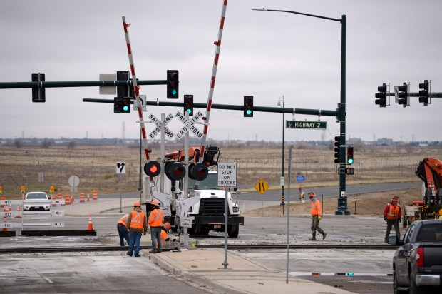 Crews work on the rail line at E. 80th Ave., one of the streets accessing the community of Irondale on Nov. 7, 2017 in Commerce City.