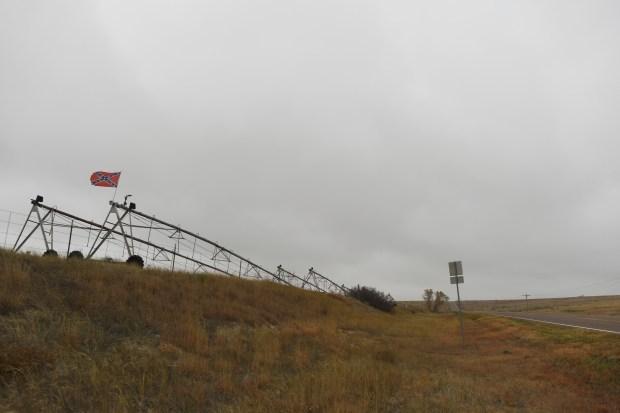 A confederate flag flies atop an ...
