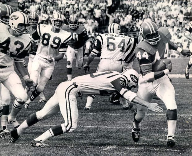 SEP 22 1969; Here Comes..There Goes Floyd--Floyd Little (44) of the Denver Broncos avoids the tackle of Jet player Steve O'Neal (20) and continues on his way to the New York Jet 1-yard line where he was tripped up. Little returned a Jet kick for 56 yards during the second quarter to set up a Denver touchdown on the next play. Jet players in background are; John Dockery (43), Stewart Wayne (89) and Pete Perreault. The Broncos scored an upset 21-19 win over the Jets before a standing-room only crowd of 51,000 in Denver. 69; (Photo By The Denver Post via Getty Images)