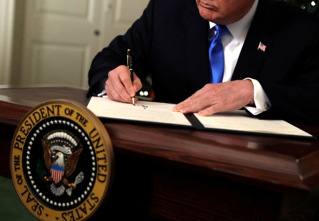 President Donald Trump signs a proclamation to recognize Jerusalem as the capital of Israel on Wednesday at the White House.