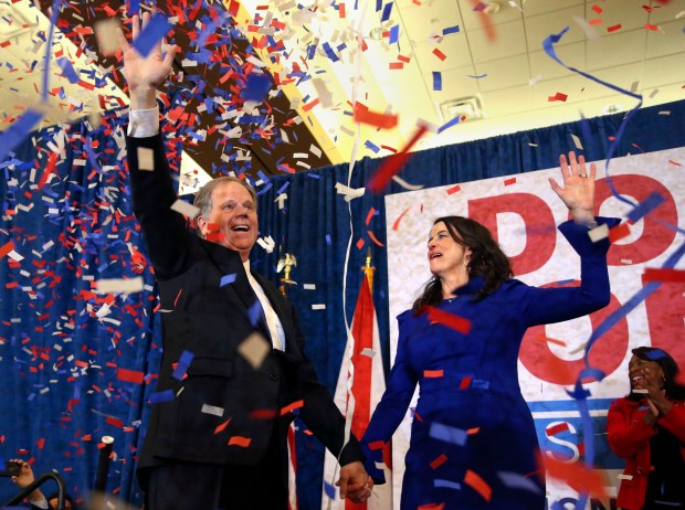 Doug Jones and his wife, Louise, wave to supporters before he speak Tuesday evening in Birmingham, Ala. Jones defeated Republican Roy Moore in Alabama's special election to replace Jeff Sessions in the U.S. Senate.