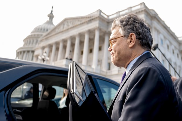 Sen. Al Franken, D-Minn., leaves the U.S. Capitol Thursday after saying he will resign in coming weeks following a wave of sexual misconduct allegations and a collapse of support from his Democratic colleagues.