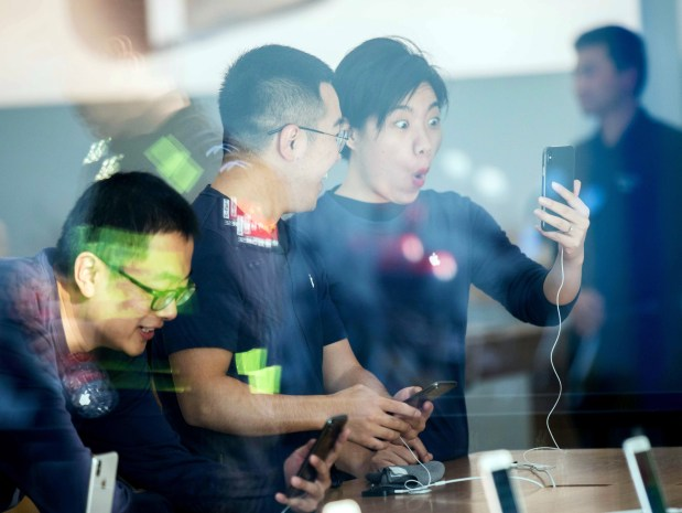Customers look at the new iPhone X at the Apple store in Hangzhou, China, on Nov. 3. The $999 iPhone's most-discussed feature is its facial recognition technology.