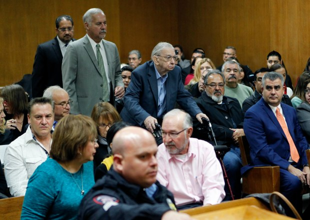 Former priest John Feit, center, enters the courtroom for closing arguments in his murder trial, Thursday, Dec. 7, 2017, at the Hidalgo County Courthouse in Edinburg, Texas. Feit is accused of suffocating Irene Garza in April 1960, after she went to confession at Sacred Heart Catholic Church in McAllen.