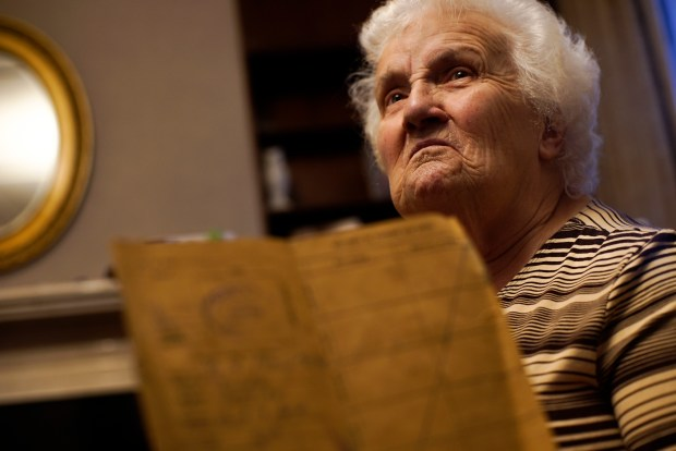 Mona Flood, 80, shows the booklet ...