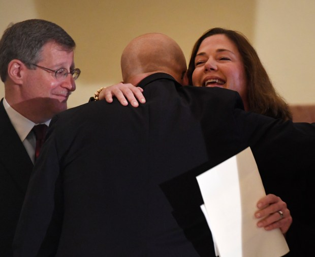 DENVER, CO - DECEMBER 14: Newly appointed Colorado Supreme Court Justice Melissa Hart, right, hugs Justice William Hood, as Justice Richard Gabriel, left, waits to greet Hart just before a press conference announcing her appointment by Gov. John Hickenlooper at the Colorado State Capitol December 14, 2017. (Photo by Andy Cross/The Denver Post)