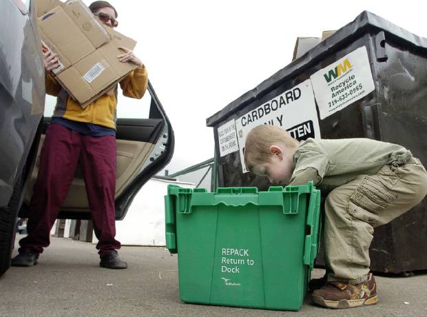 Liam Everett, 5, helps his mother Sarah unload their recycling at Recycle America Wednesday afternoon, April 16, 2008. They make a recycling run a couple of times a month.