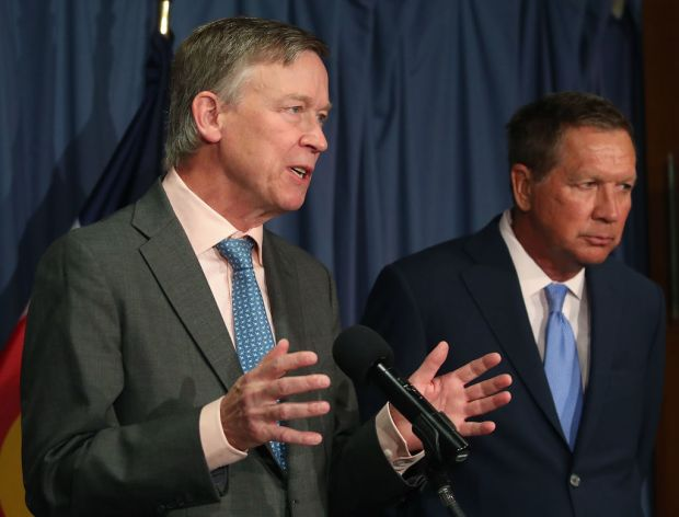 Gov. John Hickenlooper (D-CO) (L) and ...