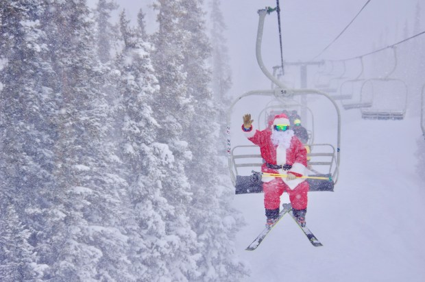 Santa rides a chairlift at Loveland Ski Area on Christmas Day.