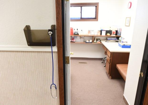 A stethoscope hangs outside a room ...