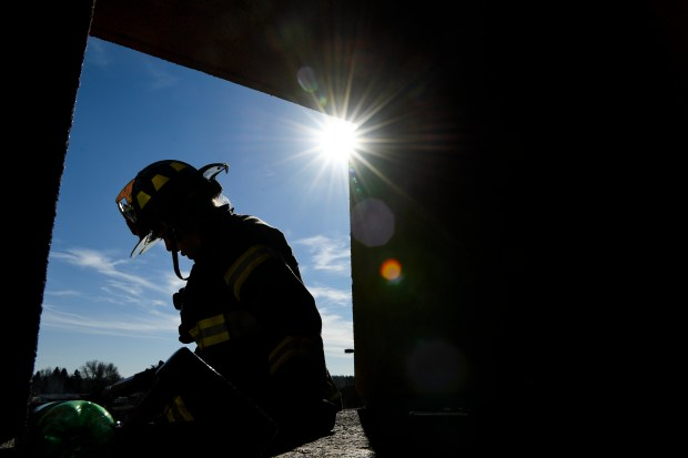 Probationary firefighter Shannan Stensvad works on ...