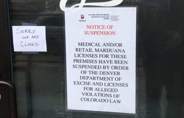 Sweet Leaf Marijuana Center at 2609 Walnut St in Denver, displaying a Notice of Suspension from the City of Denver Department of Excise and Licenses.