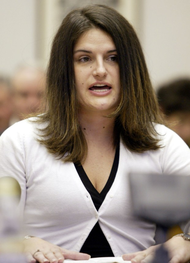Former University of Colorado student Lisa Simpson testifies before the Colorado state Senate Judiciary Committee regarding rape victim identity and rights at the Colorado Capitol on Jan. 28, 2004.