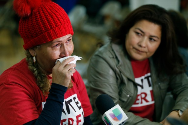 El Salvador immigrants Diana Paredes, left, and Isabel Barrera react at a news conference following an announcement on Temporary Protected Status for nationals of El Salvador in Los Angeles on Monday. The Trump administration said it is ending special protections for Salvadoran immigrants, an action that could force nearly 200,000 to leave the U.S. by September 2019 or face deportation.