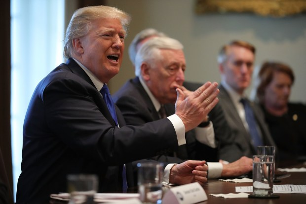 President Donald Trump presides over a meeting about immigration with Republican and Democratic members of Congress on Tuesday at the White House.
