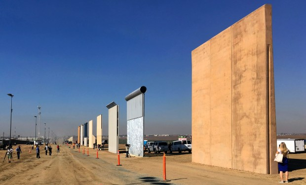 This Oct. 26, 2017 file photo shows prototypes of border walls in San Diego. Rigorous testing of prototypes of President Donald.  A U.S. official says recent testing of prototypes of President Donald Trump's proposed wall with Mexico found their heights should stop border crossers. U.S. tactical teams spent three weeks trying to breach and scale the models in San Diego. An official with direct knowledge of the results said they point to see-through steel barriers topped by concrete as the best design. The official spoke to The Associated Press on condition of anonymity because the information is not authorized for release.