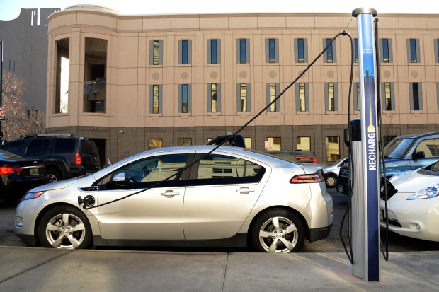 A public on-street EV charging station at 14th Avenue and Bannock Street in Denver.